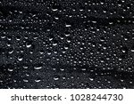 water drops on black background ... | Shutterstock . vector #1028244730
