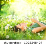 beautiful young woman lying on... | Shutterstock . vector #1028248429