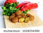 falafel balls sweet red pepper... | Shutterstock . vector #1028256580