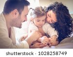 happy parents with their little ... | Shutterstock . vector #1028258749
