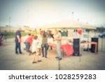 blurred group of people enjoy... | Shutterstock . vector #1028259283