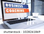 business coaching text on... | Shutterstock . vector #1028261869