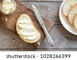 butter and bread for breakfast  ... | Shutterstock . vector #1028266399