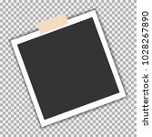 photo frame with sticky tape on ... | Shutterstock .eps vector #1028267890