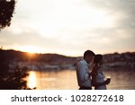 two young people enjoying a... | Shutterstock . vector #1028272618