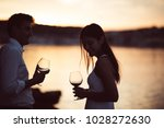 two young people enjoying a... | Shutterstock . vector #1028272630