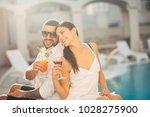 loving couple spending vacation ... | Shutterstock . vector #1028275900