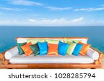 wooden sofa bed with colorful... | Shutterstock . vector #1028285794