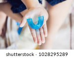 three year old boy shows... | Shutterstock . vector #1028295289