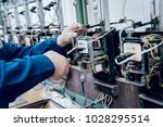 electrician worker checking... | Shutterstock . vector #1028295514