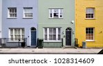 a terrace of small old painted... | Shutterstock . vector #1028314609