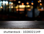 empty wooden table platform and ... | Shutterstock . vector #1028321149