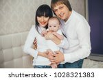the father and mother embracing ... | Shutterstock . vector #1028321383