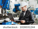 young engineer with laptop in... | Shutterstock . vector #1028331244