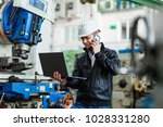 young successful engineer looks ... | Shutterstock . vector #1028331280