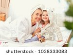 mother and daughter in... | Shutterstock . vector #1028333083