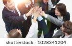 closeup. joyful business team... | Shutterstock . vector #1028341204