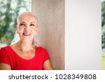 attractive older woman with a... | Shutterstock . vector #1028349808