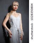 beautiful girl in designer...   Shutterstock . vector #1028350804