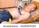 cardiology. the cardiologist... | Shutterstock . vector #1028354104
