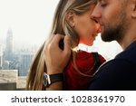 man holds woman tender standing ... | Shutterstock . vector #1028361970