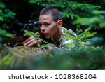 teenager hunting and shoot from ... | Shutterstock . vector #1028368204