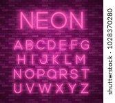 realistic neon alphabet. bright ... | Shutterstock .eps vector #1028370280
