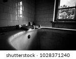 abandoned sanatorium. old bath... | Shutterstock . vector #1028371240