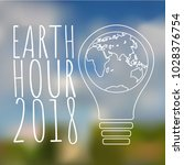 earth hour poster on blured... | Shutterstock .eps vector #1028376754