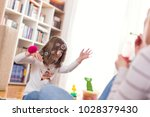 mother and daughter playing ...   Shutterstock . vector #1028379430