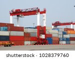 container terminal image | Shutterstock . vector #1028379760