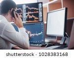 stockbroker in shirt is working ... | Shutterstock . vector #1028383168