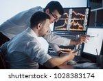 team of stockbrokers are having ... | Shutterstock . vector #1028383174