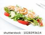 rocket salad with fried shrimps ... | Shutterstock . vector #1028393614