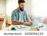 smiling modern young freelancer ... | Shutterstock . vector #1028396110