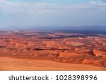 aerial view of high red dunes ... | Shutterstock . vector #1028398996