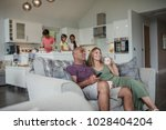husband and wife relaxing on... | Shutterstock . vector #1028404204
