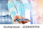 view of a businessman using a... | Shutterstock . vector #1028405554