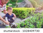 asian father teaching cute...   Shutterstock . vector #1028409730