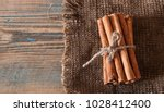 cinnamon sticks wrapped with... | Shutterstock . vector #1028412400
