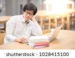 young asian man university... | Shutterstock . vector #1028415100