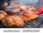 grilled chicken thigh on the... | Shutterstock . vector #1028422504