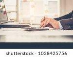 a businessman analyzing... | Shutterstock . vector #1028425756
