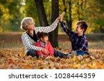 grandmother granddaughter and... | Shutterstock . vector #1028444359