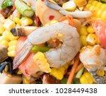 spicy papaya corn salad with... | Shutterstock . vector #1028449438