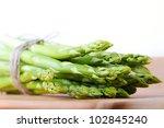 bunch of green asparagus on... | Shutterstock . vector #102845240