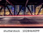 the light trails on the bridge... | Shutterstock . vector #1028464099