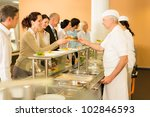 Stock photo business colleagues in cafeteria cook serve fresh healthy food meals 102846593