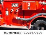 closeup fire truck emergency... | Shutterstock . vector #1028477809
