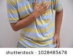 men have severe heart attacks. | Shutterstock . vector #1028485678